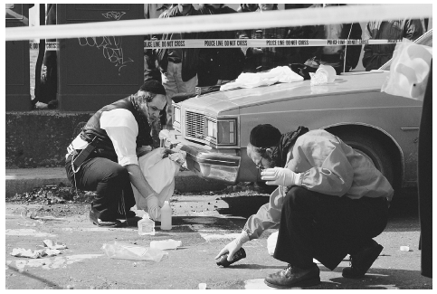 Jewish officers in Brooklyn, New York, clean blood from the scene of a shooting according to tradition. MARK PETERSON/CORBIS