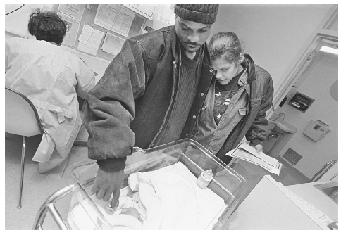 Couple visits with their newborn who will be placed in foster care. Toxicology tests revealed that the baby was born addicted to cocaine. BRENDA ANN KENNEALLY/CORBIS