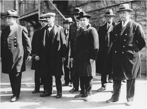Italian immigrants Nicola Sacco and Bartolomeo Vanzetti (middle, foreground) were accused of killing a paymaster and stealing about 16,000 in 1920. Many believed they were convicted and executed in 1927 because of their anarchistic beliefs. AP/