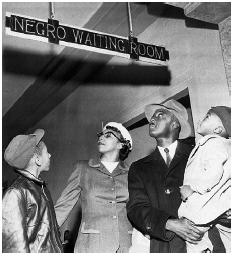 Jim Crow in bold relief. Dr. and Mrs. Charles Atkins and their sons Edmond and Charles Jr. wait inside a train depot in Oklahoma City, November 1955. [AP/WIDE WORLD PHOTOS]