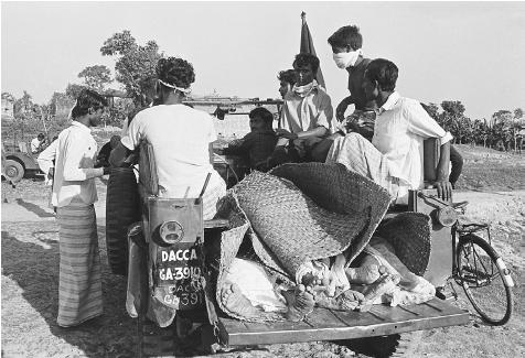 East Pakistanis were struggling for independence from Pakistan in 1971 when the Pakistani Army inaugurated a genocide there. Here, in a photo taken in Dhaka (or Dacca), corpses are transported for burial. [BETTMANN/CORBIS]