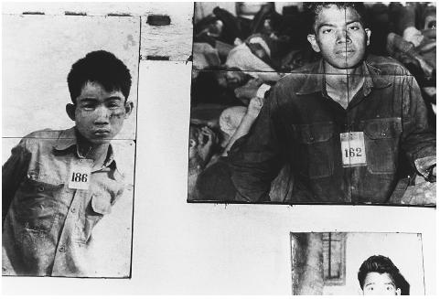 The faces of alleged dissidents murdered by the Khmer Rouge at the secret Tuol Sleng (S21) security office in Phnom Penh, c. 1978. Victims were photographed prior to interrogation and execution. HOWARD DAVIES/CORBIS]