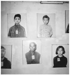 More photographs of prisoners of the Khmer Rouge, taken at the time of their admission to Tuol Sleng, prior to execution. The building is now preserved as the Tuol Sleng Museum. [HOWARD DAVIES/CORBIS]