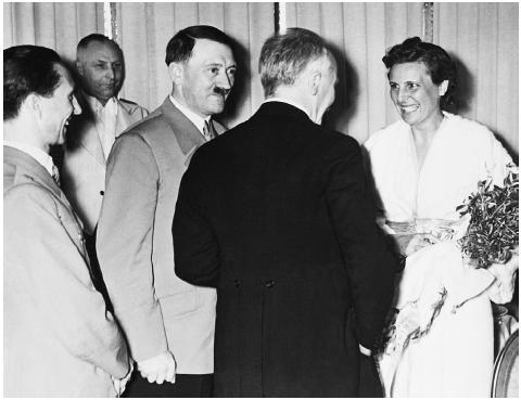 Though she later tried to minimize her collaboration with the Nazis, an ebullient Leni Riefenstahl is received by Adolf Hitler and Joseph Goebbels, April 29, 1938. Riefenstahl, who first heard Hitler speak in 1932 and was dazzled, made propagan