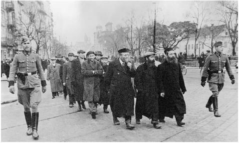 The Gestapo routinely rounded up undesirables. Here, Warsaw Jews are force-marched from the city for transport to concentration camps in the east, March 27, 1940. [BETTMANN/CORBIS]