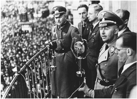 Himmler preparing to address a crowd gathered at the town hall in Linz, Austria, in 1938, after the Nazis had invaded that country. Answerable only to Hitler, he soon became responsible for removing all undesirables from territories conquered b