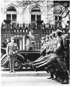 Adolf Hitler in front of an SA parade in Berlin in honor of his birthday, April 20, 1938. [AP/WIDE WORLD PHOTOS]