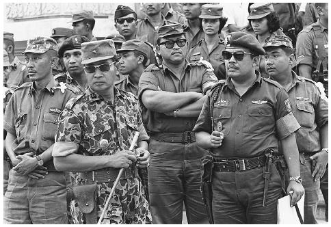 Major General Suharto (in camouflage fatigues) in an October 6, 1965, photograph. Suharto, right-wing dictator and President of Indonesia from 1967 to 1998, ruled through military control and media censorship. When East Timor, a Portuguese colo
