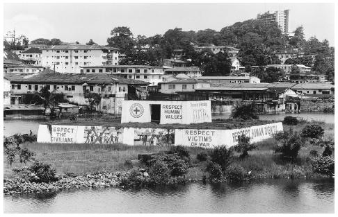 ICRC compound in Monrovia, Liberia, implores warring factions to avoid civilian casualties. Summer of 2003. [TEUN VOETEN]