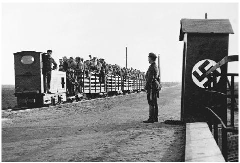 In the 1930s the Nazis primarily used forced labor camps for punishment, and as a means of instilling discipline and socially acceptable behavior. Here, German political prisoners await transport to a nearby labor camp in Land Niedersachsen (We