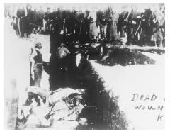 A mass burial in the aftermath of the Wounded Knee massacre, 1890. [CORBIS]