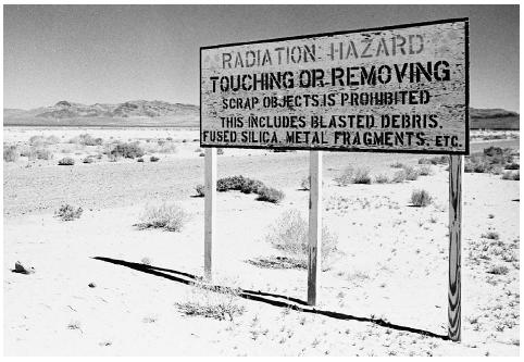 A hazardous warning sign marks Frenchmans Flat, the Atomic Energy Commissions former nuclear proving ground near Mercury, Nevada. The site of numerous tests for four decades starting in the late 1940s, it is not far from the increasingly popula