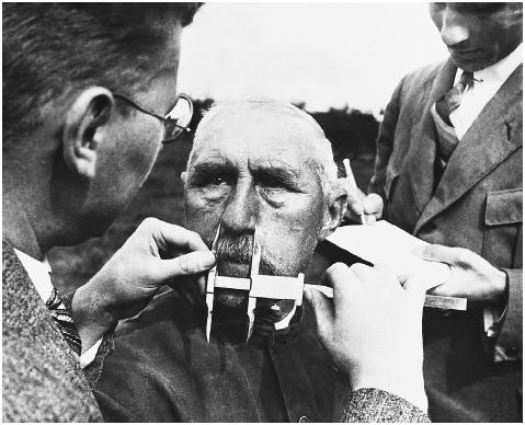 Does race exist? Scientific studies of DNA sequences give way to the conclusion that it does not (that the term, as applied to the human species, has no concrete meaning). Here, in 1941, German officials use calipers to take measurements of a m