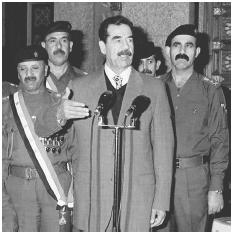 A loyal, often fanatical, military were key to Saddam Husseins continued rule and murderous campaigns in Iraq. Here, the dictator honors his officers, Baghdad, January 2000. [AFP/CORBIS]