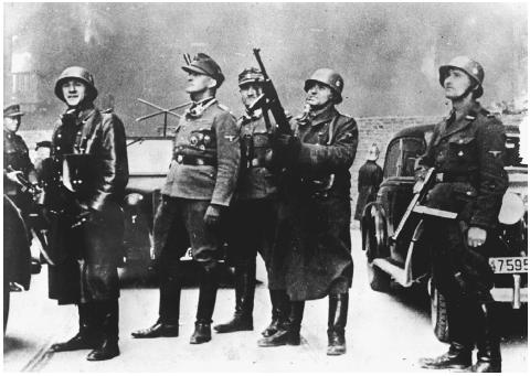 Here, SS General Jurgen Stroop and German soldiers prepare to quell the Warsaw uprising, August 1943. One of many photos that Stroop later included in his report to the Nazi high command detailing his success in liquidating the Jewish ghetto. [