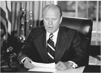 President Gerald Ford tells the nation that he is pardoning former president Richard Nixon for all Watergate-related offenses. AP/Wide World Photos.