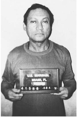 Panamanian military leader Manuel Noriega, following his capture in 1989. President George Bush had sent fourteen thousand troops to Panama without congressional approval to capture Noriega, who was eventually accused of election fraud and drug