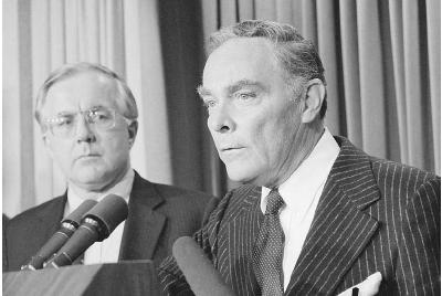 Secretary of State Alexander Haig speaks to the press following the assassination attempt on President Ronald Reagan, March 30, 1981. National security advisor Richard Allen looks on as a shaken Haig declares, I am in control here pending retur