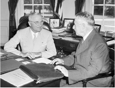 President Harry S. Truman (left) is briefed by Secretary of War Henry L. Stimson on August 8, 1945, two days after the United States dropped an atomic bomb on Hiroshima, Japan. As vice president, Truman was unaware of U.S. plans for the atomic