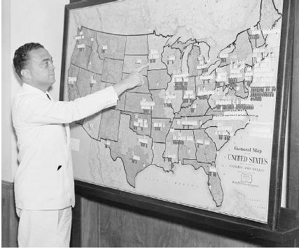 The face of the FBI for 48 years was J. Edgar Hoover, standing here in July 1935 in front of a map that shows the locations of FBI agents. Bettmann/Corbis.