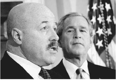 President George W. Bush (right) and homeland security secretary nominee Bernard Kerik, on December 3, 2004. Kerik, the former New York City police commissioner, who was at the helm during the September 11, 2001, terrorist attacks, withdrew his