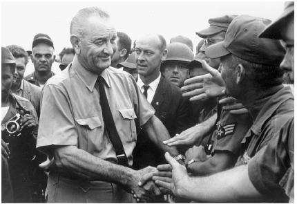 President Lyndon B. Johnson greets U.S. troops in Vietnam in 1966. National Archives and Records Administration.