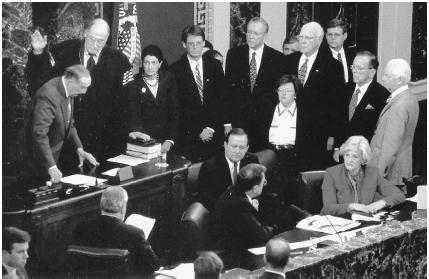 U.S. senator J. Strom Thurmond of South Carolina (far left) swears in Supreme Court chief justice William Rehnquist before the start of the Senate impeachment trial of President Bill Clinton on January 1, 1999. AP/Wide World Photos.