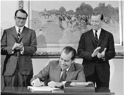 President Richard Nixon signs the Clean Air Act on December 31, 1970. Behind Nixon are (left) William D. Ruckelshaus, head of the Environmental Protection Agency, and Russell Train, chairman of the Council on Environmental Quality. AP/Wide Worl