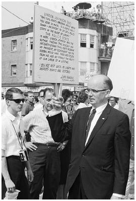 Lester Maddox, owner of the Pickrick Motel in Atlanta, Georgia, pickets outside the Atlantic City Convention Hall, where the Democratic Party was holding its convention in August 1964. Maddox was against the Civil Rights Bill of 1964. Bettmann
