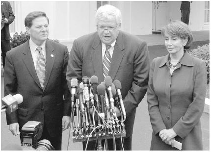 Congressional leaders speak with the media following a meeting with President George W. Bush in March 2003: (left to right) House majority leader Tom DeLay of Texas, Speaker of the House Dennis Hastert of Illinois, and House minority leader Nan