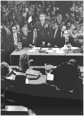 Lt. Col. Oliver North is sworn in before his testimony before a congressional committee investigating the Iran-Contra scandal in July 1987. Special committees are frequently formed to investigate governmental problems. AP/Wide World Photos.