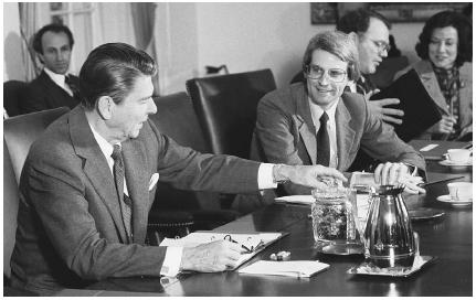 Preparing the federal budget is a critical responsibility that both the executive and legislative branches have a hand in. Here, President Ronald Reagan (left) offers budget director David Stockman some jelly beans during a budget meeting in th