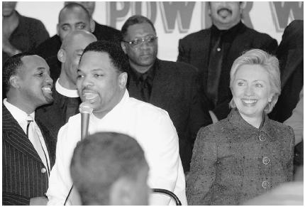 First lady Hillary Rodham Clinton listens to Hezekiah Walker of the Love Fellowship Tabernacle in Brooklyn, New York, during a U.S. Senate campaign appearance on November 5, 2000. Two days later, she was victorious. Getty Images.