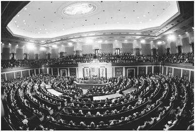 A birds-eye view of President Bill Clinton delivering the State of the Union Address to members of Congress and to U.S. Supreme Court justices in the U.S. Capitol on February 4, 1997. Wally McNamee/Corbis.