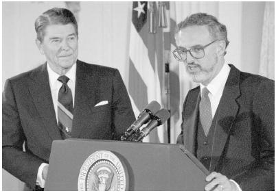 As President Ronald Reagan (left) watches, Douglas Ginsburg addresses the audience after being nominated to be a Supreme Court associate justice in October 1987. Ginsburg soon withdrew from consideration after it was divulged that he had used m