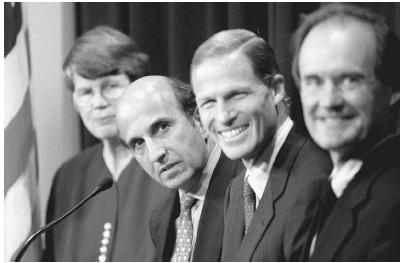 Four attorneys involved in the Microsoft monopoly case in 1999: (left to right) U.S. attorney general Janet Reno, U.S. assistant attorney general Joel Klein, Connecticut attorney general Richard Blumenthal, and U.S. Justice Department trial att