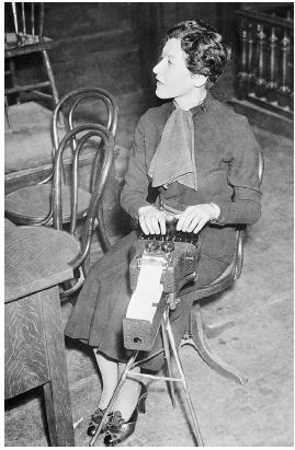 Court stenographer Dorothy Siegal records testimony on a stenotype machine during the 1935 trial of Bruno Hauptmann, who was charged with the kidnapping and murder of the son of famed pilot Charles A. Lindbergh.  Bettmann/Corbis.
