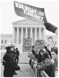 Supporters for Vice President Al Gore and Texas governor George W. Bush square off in front of the U.S. Supreme Court building on December 11, 2000, amidst the fight over who would be victorious in the 2000 presidential election. Reuters/Corbi