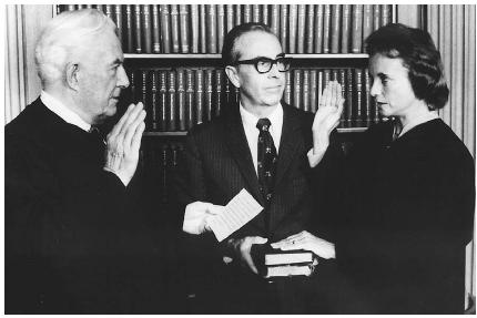 Sandra Day OConnor is sworn in as the first woman on the U.S. Supreme Court in September 1981. Husband John J. OConnor holds two family Bibles as Chief Justice Warren Burger swears in his new colleague. AP/Wide World Photos.