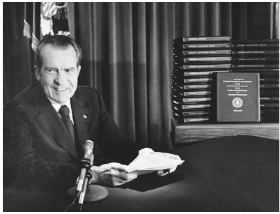 President Richard Nixon sits in front of secret Oval Office recordings that the U.S. Supreme Court ruled unanimously on July 24, 1974, should be released to Watergate prosecutors. Nixon had attempted to keep them from being turned over, citing
