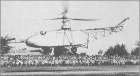 Igor Sikorsky pilots his craft, the VS-300, close to the ground in this 1943 demonstration.