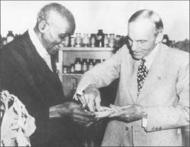 George Washington Carver, left, and industrialist Henry Ford share a weed sandwich in this 1942 photograph.