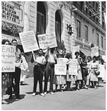 Demonstrators picket outside the Sheraton-Blackstone Hotel in Chicago, where a Republican Party subcommittee meeting was taking place, July 21, 1960. Demands for an end to discrimination in the sale and rental of residential housing were met by the Fair Housing Act, enacted on April 11, 1968. (©;BETTMANN/CORBIS)