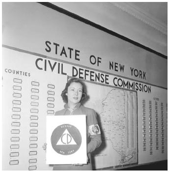 "An employee of the Civil Defense Commission of New York State displays the official ""CD"" logo, November 1950ust over a year after the Soviet Union tested its first atomic bomb. (©BETTMANN/CORBIS)"