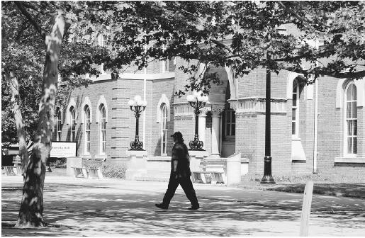 A student at Ohio State University, one of about 70 land grant universities created under the Morrill Act, walks in front of University Hallhe site where 24 students gathered for the first class of the Ohio Agricultural and Mechanical College on September 17, 1873. (© AP/WIDE WORLD PHOTOS)