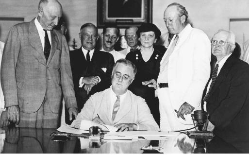 President Franklin D. Roosevelt signs the Social Security Act, 1935. Standing immediately behind Roosevelt (left to right) are Representative Robert Doughton, Senator Robert Wagner, Secretary of Labor Frances Perkins, Senator Pat Harrison, and Representative David J. Lewis. (LIBRARY OF CONGRESS, PRINTS AND PHOTOGRAPHS DIVISION)