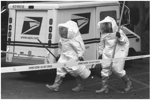 A decontamination crew responds to a possible release of anthrax by terrorists at a United States postal facility in 2001.