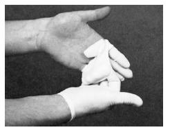 Proper removal of used gloves. (Delmar Publishers, Inc. Reproduced by permission.)