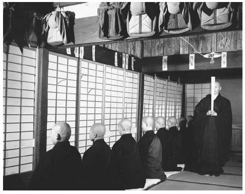 Row of Zen Buddhist nuns with shaved heads and dark robes.. (Horace Bristol/Corbis. Reproduced by permission.)