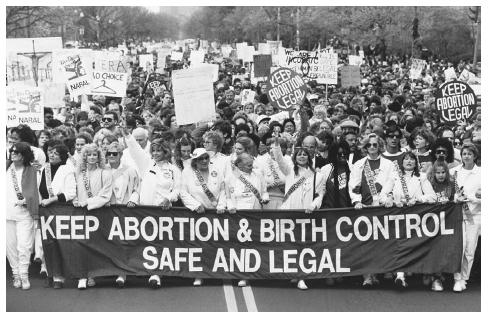 Abortion rights supporters march through Washington. (UPI/Corbis-Bettmann. Reproduced by permission.)
